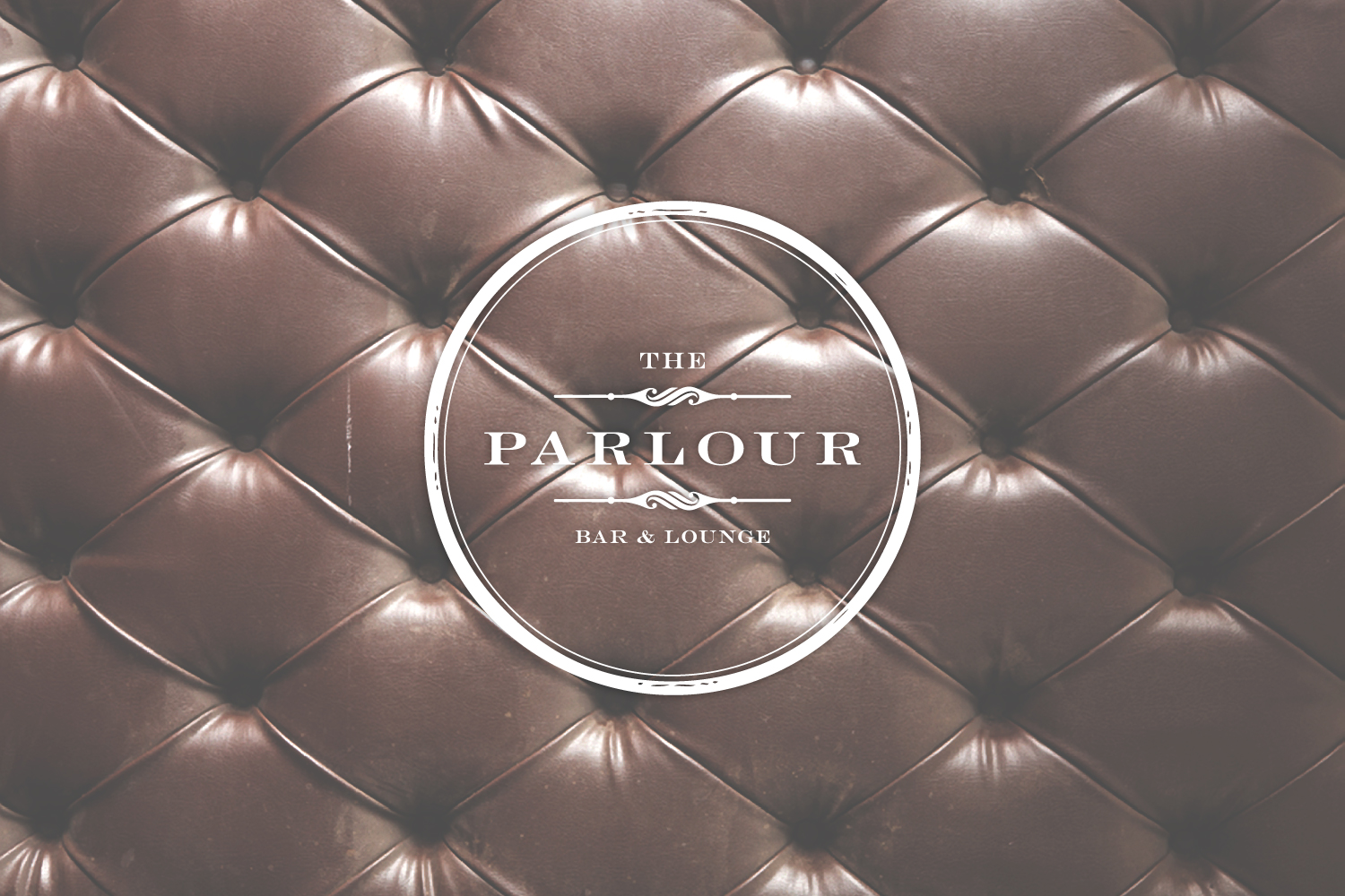 the parlour circle vintage logo on tufted brown leather image, bar and lounge, las vegas nevada, logo design, upscale bar, luxurious leather club chairs