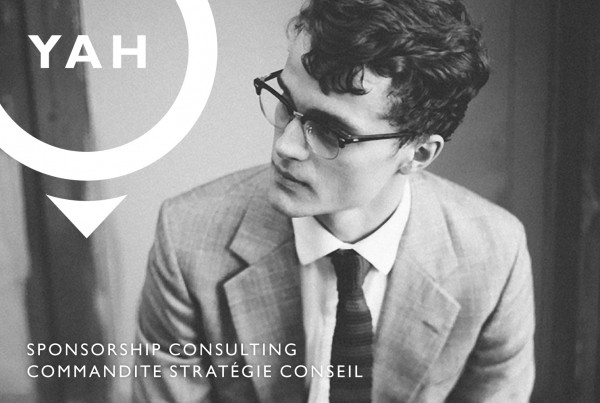 yah strategies logo design over image of man in suit and tie, black and white image, 1950s, vintage, mad men inspired, branding