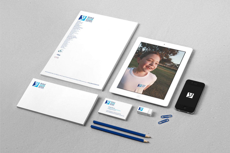 akiva school stationery layout, letterhead design, envelope design, business card design, image of boy with akiva tshirt on ipad, branding, logo design, blue, print design